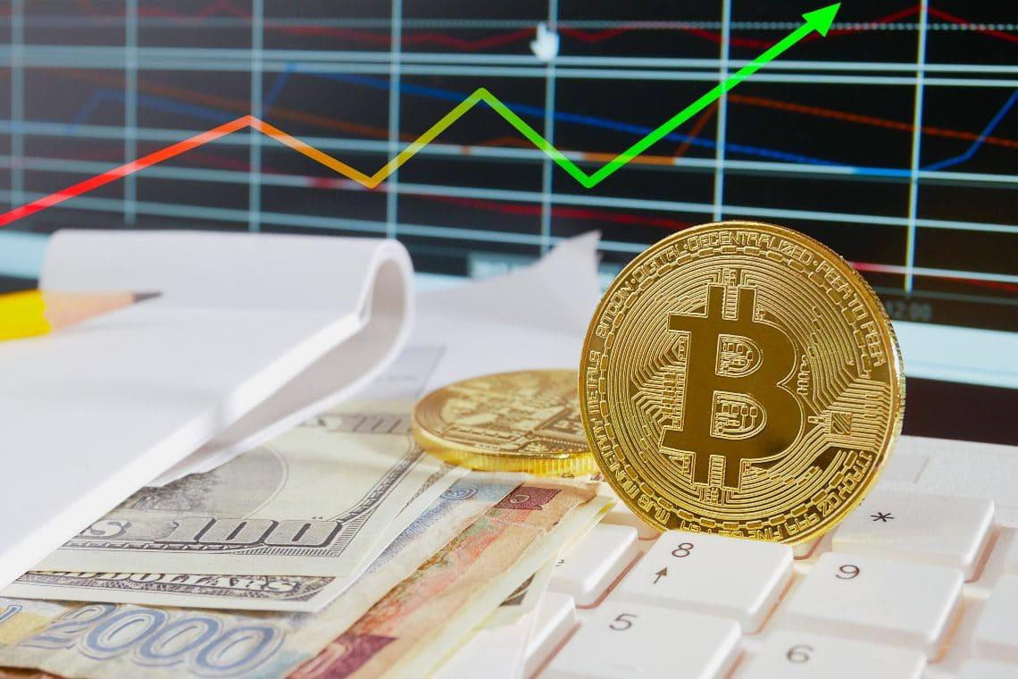 Bitcoin sets new record above $23,000